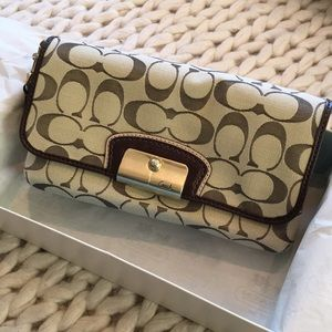 Brand-new Coach wristlet, with tag and gift box
